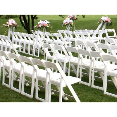 White resin folding chairs are lined up