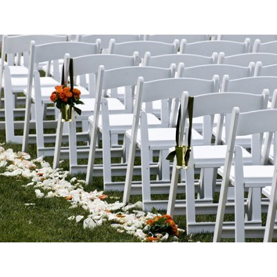 Resin folding chairs at wedding ceremony setup